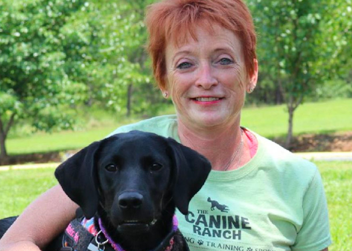 Jeanne Headshot with Labrador Retriever - dog trainers near atlanta